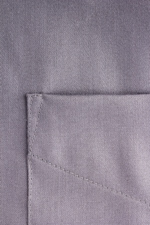 Close-up photograph of a pocket on a silver shirt. photo