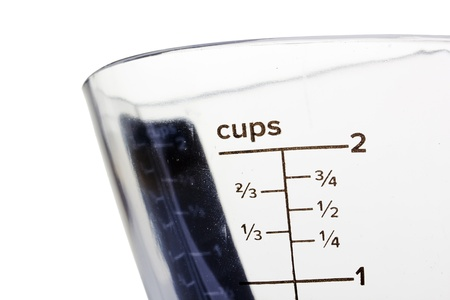 ガラス製の容器での測定のクローズ アップ写真。 写真素材