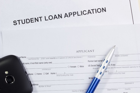 Directly above photograph of a student loan application. Stock Photo - 13408607