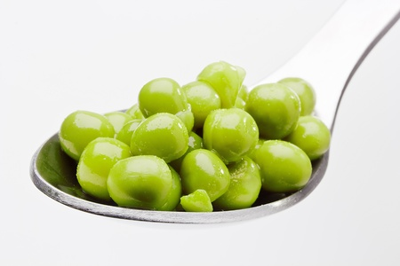 Close-up photograph of green peas on a spoon. Stock Photo - 13408663
