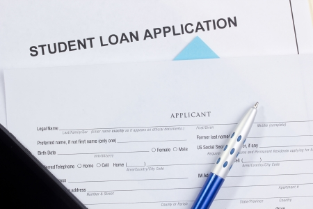 Directly above photograph of a student loan application. Stock Photo - 13408660