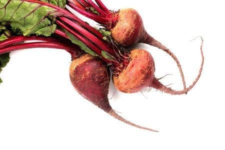 Natural red beets on a white background.