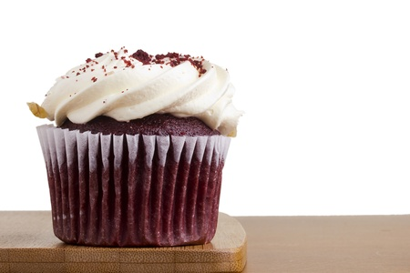 Decorated red velvet cupcake on a white background. photo