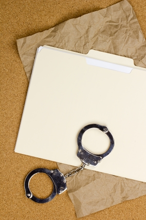 Directly above photograph of handcuffs and a folder.