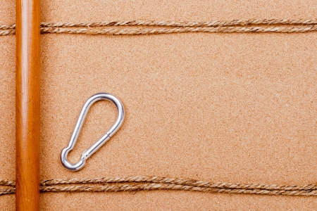 Directly above photograph of an old rope and a carabiner. photo