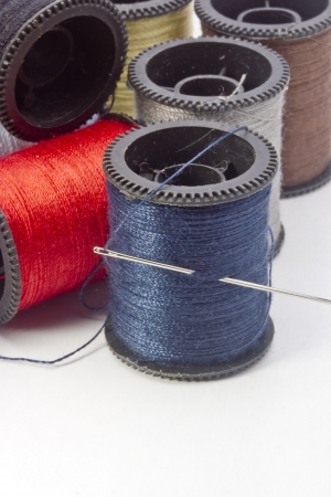 Variety of thread spools on a white background. Stock Photo - 13848939