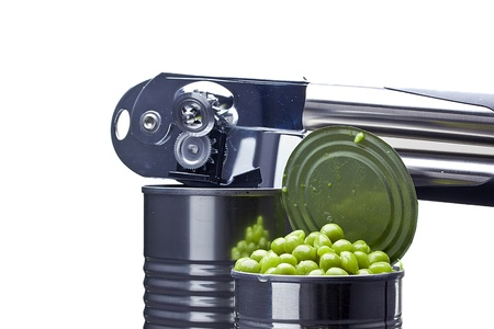 Preserved green peas in a metal can next to a can opener on a white background. Stock Photo - 14025818