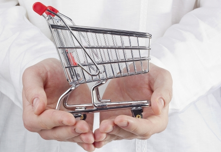 Close-up photograph of man's hands holding a shopping cart. Stock Photo - 14120553