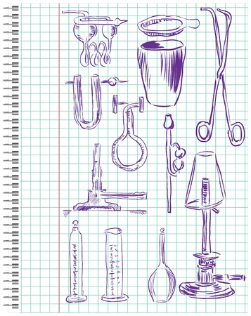 A set of chemical equipment in a school notebook in the box.