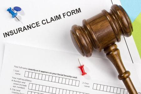 Directly above photograph of an insurance claim form. photo
