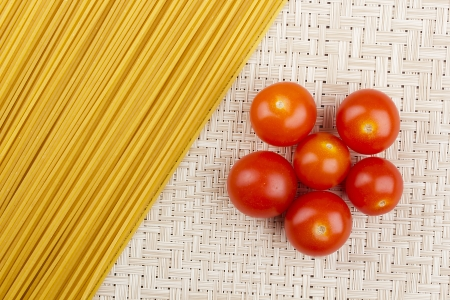 Directly above photograph of red tomatoes and pasta. Stock Photo - 14793130