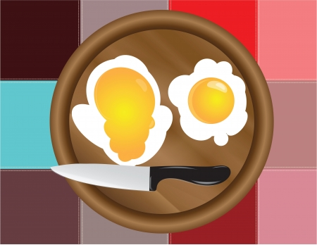 scenical: Fried eggs on the kitchen board with a decorative cloth.