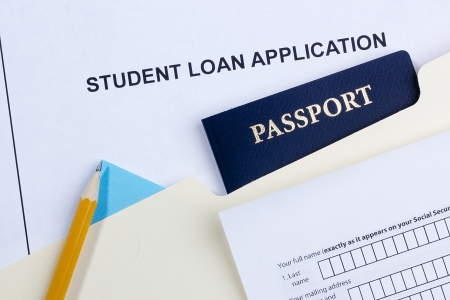 overseas visa: a student loan application and a passport.
