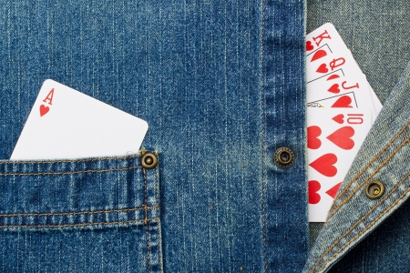 Close-up photograph of playing cards on denim material. photo