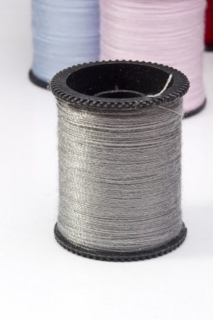 Close-up photograph of a silver spool of thread. photo
