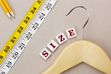 measuring tape: Close-up photograph of a wooden hanger and measuring tape next to the word  Stock Photo