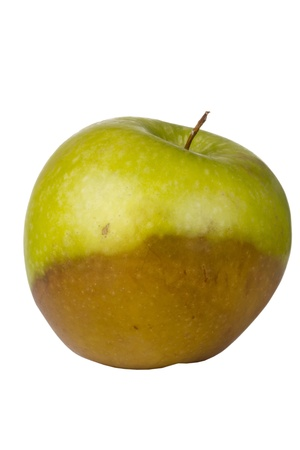 bad apple: Decaying green Granny Smith apple isolated on a white background. Stock Photo