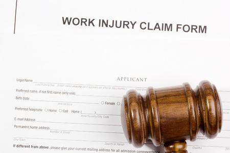 Directly above photograph of a work injury claim form. Reklamní fotografie - 15712638