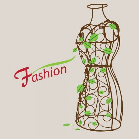 Creative on fashion. Vintage mannequin with leaves.