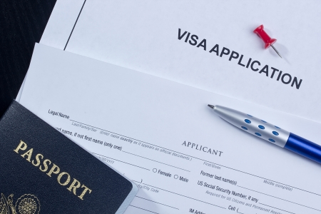 Directly above photograph of an application for a visa. Standard-Bild