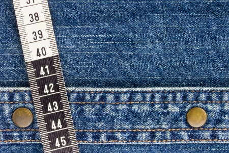 Close-up photograph of measuring tape on denim material. Stock Photo - 16060068