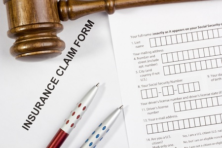 Directly above photograph of an insurance claim form. Stock Photo - 16244414