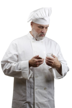 Portrait of a caucasian chef in his uniform on a white background.