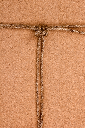 Directly above photograph of an old rope on an orange background. Stock Photo - 16332934