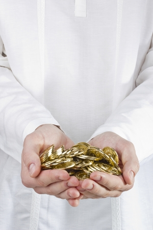hands holding golden coins. Stock Photo - 16617766