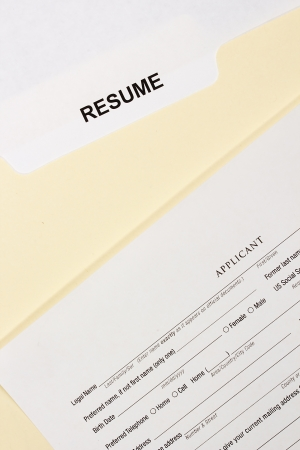 Directly above photograph of a resume and a job application. photo