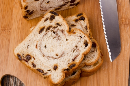 Sweet bread with cinnamon and raisins for dessert. photo