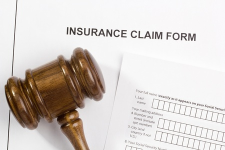 Directly above photograph of an insurance claim form.