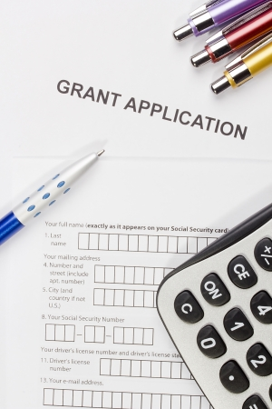 Directly above photograph of a grant application. Stock Photo