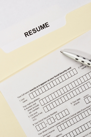 Directly above photograph of a resume and a job application. Stock Photo - 17031236
