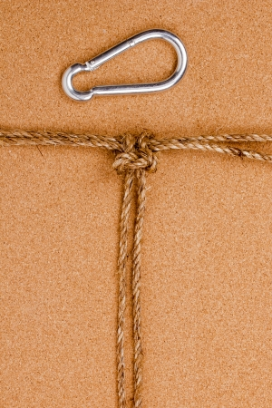 Directly above photograph of an old rope and a carabiner. Stock Photo - 17061606