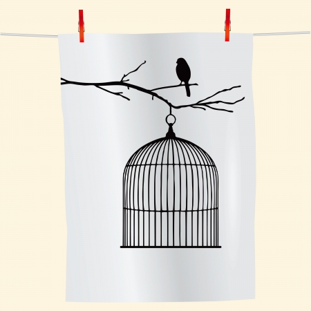 cage: The branch with the bird and an empty cage on the fabric.