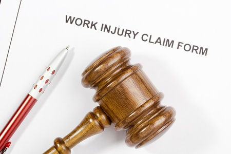 Directly above photograph of a work injury claim form. photo