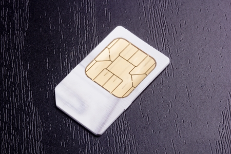 Sim card for mobile communication. Electronic devices. photo