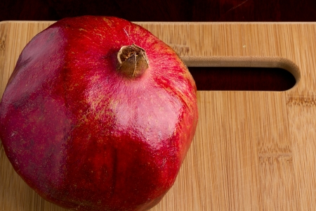 The fruit of Pomegranate on the kitchen blackboard. photo