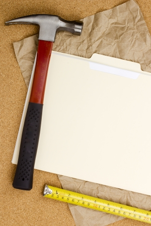 Directly above photograph of a hammer, measuring tape, and a folder. 版權商用圖片