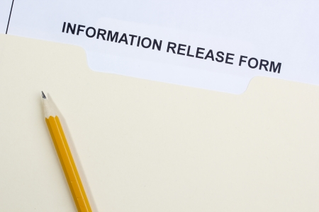private information: Directly above photograph of an information release form. Stock Photo