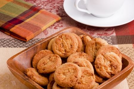 Cookies with caramel filling in a wooden bowl. photo
