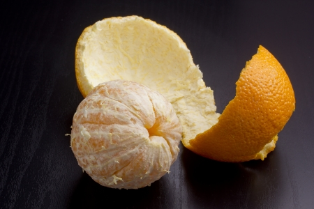 purified: Orange peel with purified on a black top. Stock Photo