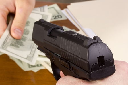 Robbery with the use of a gun in the office