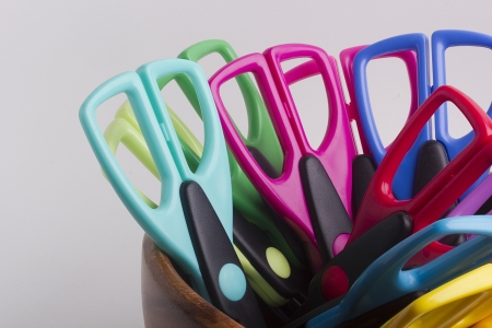 Scissors for decorative works in a wooden container .