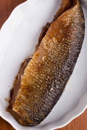 marinade: Smoked herring fillets in plate. Marinade of oil. Stock Photo