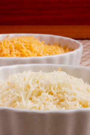 Two versions of the grated cheese in a ceramic dish.