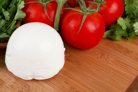 Mozzarella cheese on a wooden plate. Healthy food. photo