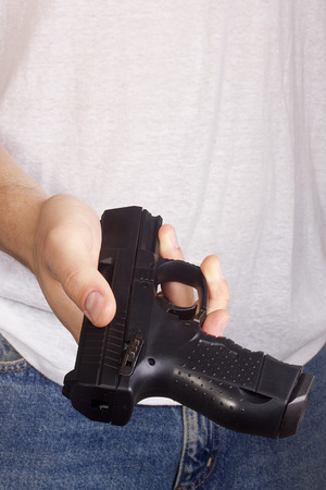 Man threatened with a gun. Control of Firearms. Stock Photo