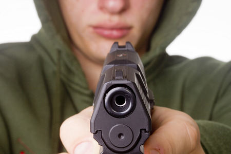 replica: Man threatened with a gun. Control of Firearms. Stock Photo